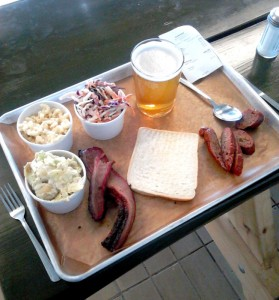 A tray of delicious meat, good enough sides and a somewhat boring pale ale at Warpigs