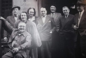 Photo at the café of the founder of Het Goudblommeke in Papier Geert van Bruaene, seated, with some of the Brussels artists, including Magritte (second from the right, with the hands in his pockets)