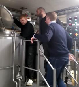 Mashing in. Amager Bryghus brewer René, Nøgne Ø's Rune and Amager Bryghus owner Morten